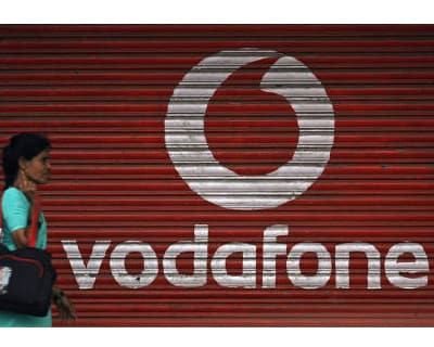 <p><b>A woman walks past a large logo of Vodafone displayed on a shop in Mumbai</b></p><p>Vodafone said on Tuesday it had filed a petition in the Supreme Court seeking protection against a notice from the India&#39;s tax authorities starting penalty