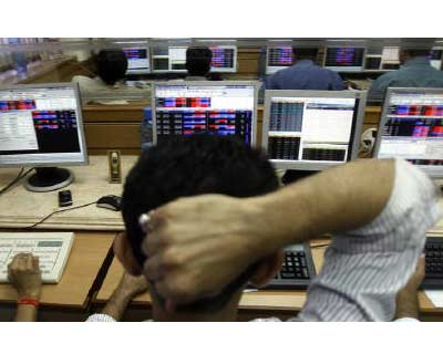 <p>A broker looks at his terminal at a stock brokerage firm in Mumbai</p><p><b>India&#39;s volatility index, a measure of near-term volatility, on Friday saw its sharpest rise in two years spiking over 30% after stock markets sank as fresh worries on