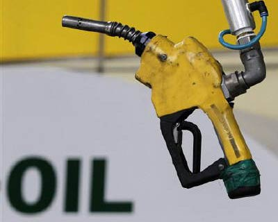 <p>A gas pump is seen hanging from the ceiling at a petrol station in Seoul</p><p><b>Brent crude oil fell below $111 a barrel on Monday, as fears of another US recession slowing fuel demand overshadowed concerns that a tropical storm may shut down so