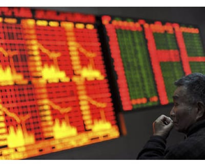 <p><b>A man looks at an electronic board showing stock information at a brokerage house in Shanghai</b></p><p>Differing prospects for interest rates sent the euro to a 14-month high against the dollar and extended the yen&#39;s steep decline on Wedne