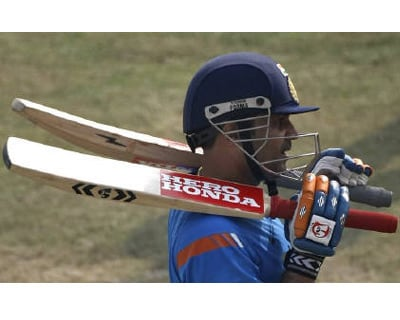 <p><b>Virender Sehwag carries his bats during a practice session in Kanpur</b> 