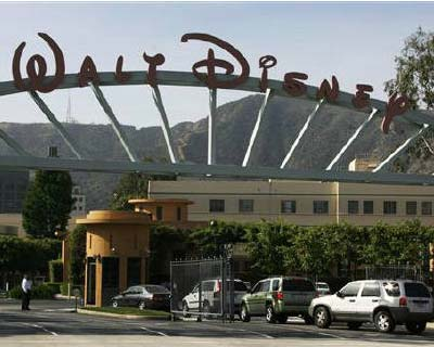 <p><b>The main gate of entertainment giant Walt Disney Co. is pictured in Burbank, California</b></p><p>Walt Disney Co will cut about 200 positions at its movie studio unit, according to a person familiar with the matter, as it reduces its focus on h