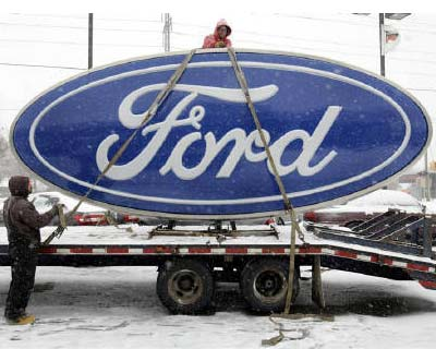 <p><b>Workers secure a Ford sign onto a truck after it was removed from Al Long Ford auto dealership in Warren, Michigan</b></p>Ford Motor Co is aiming to expand its presence in the fast-growing auto markets of India and China with an eye toward incr