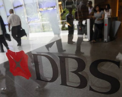 <p><b>People walk in the lobby of a DBS Bank building in Singapore </b>