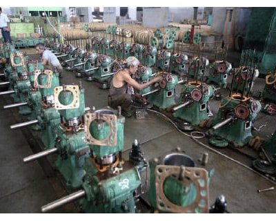 <p><b>Technicians work on engines used for water pumps inside a manufacturing unit in Rajkot, 216 km (134 miles) west of Ahmedabad</b> </p><p> India&#39;s annual industrial output in December rose at its slowest pace in 20 months on a higher base l