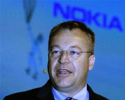 <p><b>Mobile telecommunication giant Nokia&#39;s CEO Stephen Elop speaks during an award presentation in London </b> </p><p> Nokia and Microsoft have teamed up to take on Google and Apple in the fast-growing smartphone market as the Finnish cellpho