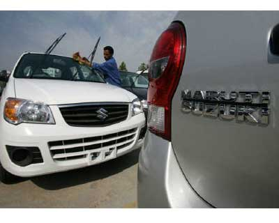 <p>A worker cleans a parked car at the Maruti Suzuki&#39;s stockyard on the outskirts of Jammu</p><p><b>Maruti Suzuki, India&#39;s top carmaker, sold less than half the cars in October as it did a year previously as labour unrest that cost around $50