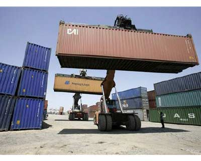 <p>Mobile cranes prepare to stack containers at Thar Dry Port in Sanand in Gujarat</p><p><b>India's exports surged nearly 82% in July as demand soared for engineering goods, petroleum products and readymade garments, but a top official warned ble