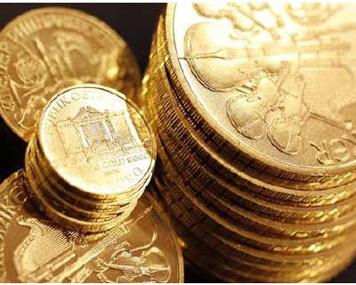<p>Wiener Philharmoniker gold coins are pictured at the Ginza Tanaka store in Tokyo</p><p><b>Gold dipped from a record high on Thursday but remained in demand by investors seeking safety from market volatility triggered by fears Europe's debt cri