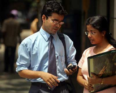 <p>Indian students look at a text message from a mobile phone in Kolkata</p><p><B>Prospects for job seekers are gloomier in most major economies than they were three months ago, as weak US and European economies begin to affect employers' confide