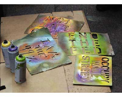 <p>Stencils used to paint slogans supporting the Occupy Wall Street movement on shirts, rest on the ground near bottles of spray paint in Zuccotti Park near the financial district of New York</p><p><b>Anti-Wall Street protesters are preparing on Frid