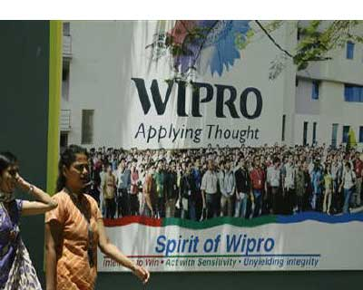 <p><b>People walk in the Wipro campus in Bangalore.</b>