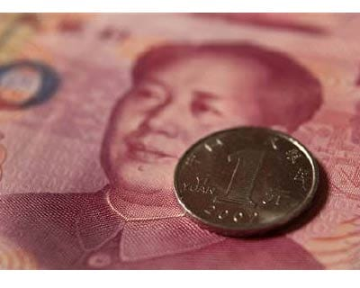 <p><b>A Chinese one yuan coin and a 100 yuan banknote are seen in this picture illustration taken in Beijing</b></p><p>The yuan hit an all-time trading peak against the dollar on Tuesday as the People&#39;s Bank of China fixed its reference rate at a