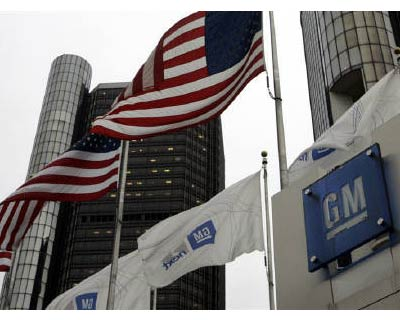 <p><b>US flags flutter in the wind in front of the General Motors Corp headquarters in Detroit, Michigan</b></p><p>From an empty auto-parts plant in the heart of Rust Belt America, General Motors Co is out to show the world that the automaker once di
