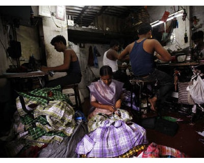 <p><b>Fifteen-year-old Saira cuts shirt threads inside a garment factory in Mumbai</b>  </p><p> The Reserve Bank of India said on Wednesday banks can classify restructured loans to microfinance companies as a &#39;special regulatory asset,&#39; a m