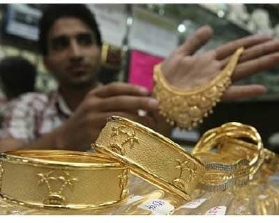 <p>A salesman displays gold ornaments at a jewellery showroom in Chandigarh</p><p><b>Gold prices rallied on Monday as a series of political setbacks over the weekend reinforced fears about the deteriorating euro zone debt crisis, prompting investors