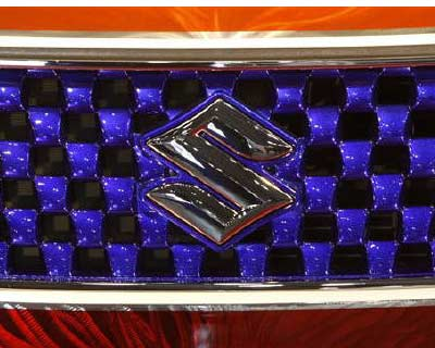 <p>Suzuki Motor Corp's logo is seen on the company's special painted minivehicle Wagon R displayed at Tokyo Auto Salon 2010 at Makuhari Messe in Chiba, east of Tokyo.<p><p><b>Volkswagen could make a move to take over Japan's Suzuki, Germa