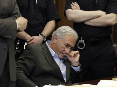 <p><b>Former IMF chief Dominique Strauss-Kahn listens to his lawyer, William Taylor, inside of a New York State Supreme Courthouse during a bail hearing in New York</b></p><p>European leaders raced on Friday to nominate a successor for fallen IMF chi