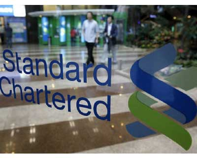 <p>Workers at SC First Bank walk in the lobby of the bank's headquarters in Seoul</p><p><b>Standard Chartered Plc forecast income growth of at least 10% this year, helped by a strong showing in Hong Kong and other Asian markets and putting it on