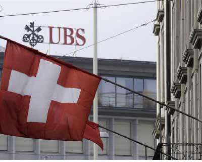 <p>A Swiss flag is seen in front of an UBS logo on Swiss bank UBS headquarters in Zurich</p><p><b>Swiss bank UBS plans to slash around 3,500 jobs in a bid to save some 2 billion Swiss francs from annual costs by the end of 2013.</b></p><p>The banks s