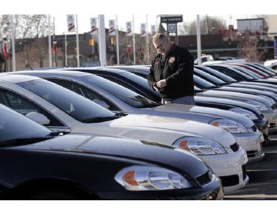 <p><b>A potential customer looks at a 2009 Chevrolet Impala sedan at a car dealership in Dearborn, Michigan </b>