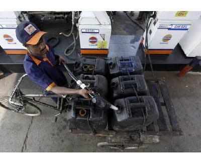 <p><b>A worker fills jerrycans with diesel at a fuel station in Kolkata</b></p><p>The government was expected to raise diesel prices on Friday, although a delay in a government meeting to decide on the politically unpopular decision raised questions