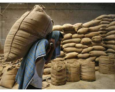 <p><b>A labourer carries a sack of wheat inside a grain-sorting unit at Sanand in Gujarat</b></p><p>India's growth story, which has excited many in recent years, is passing through a not-very-happy chapter that might last well into 2012. While In