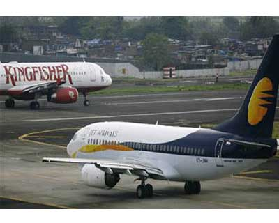 "<p>A Jet Airways aircraft (R) sits on the tarmac at the airport in Mumbai</p><p><b>The government is likely to approve a plan to allow foreign airlines to buy stakes in Indian carriers, industry secretary told Reuters on Monday.</b></p><p>""It is like"