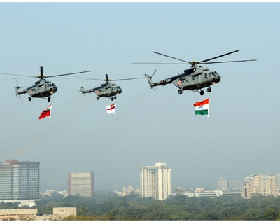 <p>The IAF Helicopters carrying the tricolour and services flag, during the 62nd Republic Day Parade-2011, at Rajpath</p>