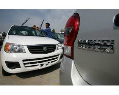<p><b>A worker cleans a parked car at the Maruti Suzuki&#39;s stockyard on the outskirts of Jammu</b></p><p>Maruti Suzuki, India&#39;s top car maker, smashed estimates with an 18% rise in June quarter profit, helped by higher other income, sending it