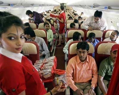 <p>Stewardesses serve passengers inside a Kingfisher Airlines aircraft in the skies over New Delhi</p><p><b>Kingfisher Airlines plans to exit its low cost business and focus on the premium model, Chairman Vijay Mallya said, in what will be a marked s