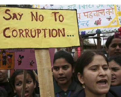 <p>School students shout slogans during a protest against a corruption case in Jammu</p><p><b>Weak under the weight of corruption scandals, the government wants to regain the initiative by reviving stalled economic reforms, but the opposition will no