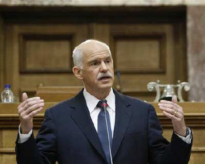 <p>Greek Prime minister George Papandreou delivers a speech to Panhellenic Socialist Movement (PASOK) parliamentary group at the parliament in Athens</p><p><b>Greek Prime Minister George Papandreou has not resigned and does not intend to, a Greek new