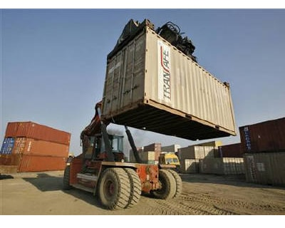 <p><b>A mobile crane prepares to stack a container at Thar Dry Port in Sanand in Gujarat</b>