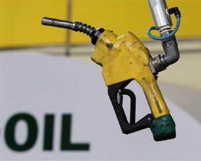 <p>A gas pump is seen hanging from the ceiling at a petrol station in Seoul</p><p><b>Oil fell more than $3 a barrel on Monday as concern over economic growth spread after Standard & Poor's cut the United States' top-tier credit rating and Eur