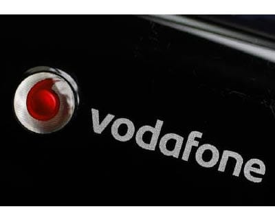 <p><b>A Vodafone logo is seen on a mobile internet dongle connected to a laptop in London</b>