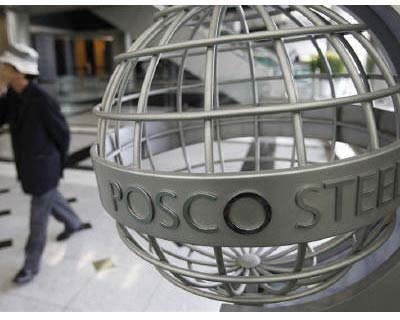 <p><b>A man walks past a logo of steelmaker Posco at the company&#39;s headquarters in Seoul</b>