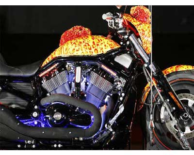 <p><b>Artist Jack Armstrong&#39;s hand painted &#39;Cosmic Starship&#39; Harley-Davidson motorcycle is unveiled at Bartels Harley-Davidson in Marina Del Rey, California</b>