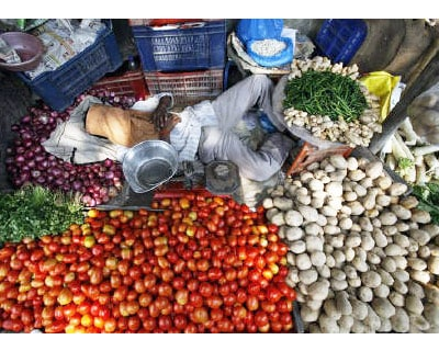 <p><b>A vegetable vendor sleeps in his roadside shop in New Delhi</b> </p><p> India&#39;s food inflation rose 12.85 per cent, while the fuel price index climbed 10.67 per cent in the year to October 23, government data showed on Thursday. </p><p>