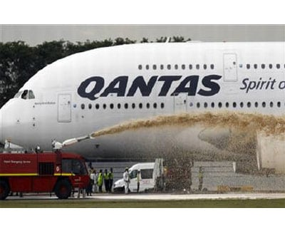 <p><b>Qantas Airways 380 passenger plane flight QF32 is sprayed by rescue services after making an emergency landing at Changi airport in Singapore</b>