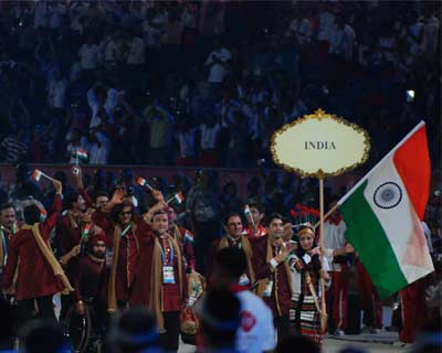 <p>The Indian team led by a girl in Naga dress with Abhinav Bindra who got the honour of leading the host nation out with the Indian flag. Bindra is an Olympic rifle champion.