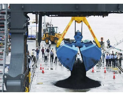 <p><b>A crane unloads coal from a ship at the Adani Cargo Port at Dahej in Gujarat</b> </p><p> Groups led by Morgan Stanley Infrastructure Fund and Global Infrastructure Partners, and the Adani Group are considering bids in the A$2 billion ($1.9 bi