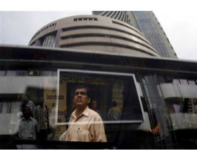 <p><b>Bombay Stock Exchange (BSE) building is reflected on a glass window in Mumbai</b>