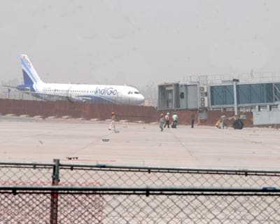 An Indigo Airlines plane and an aerobridge at Delhi Airport. The terminal, built at a cost of Rs 12,700 crore in 37 months, has four boarding piers with 48 boarding gates and 78 aerobridges, which is the highest for a terminal of its size. Three aero
