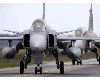 <p><b>Gripen fighter aircrafts taxi during the NATO exercise Loyal Arrow near Lulea in northern Sweden</b>