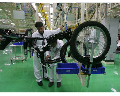 <P><B>Employees work at Hero Honda's plant.</b> 