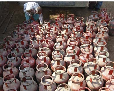<p>A vendor loads empty Liquefied Petroleum Gas (LPG) cylinders onto a truck in Mathura</p><p><b>The government needs to raise prices of subsidised fuels to achieve the budgeted fiscal deficit target of 4.6% of GDP for the current fiscal year to end-