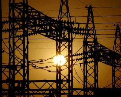 <p><b>The sun sets behind electric pylons in the northern Indian city of Allahabad</b>