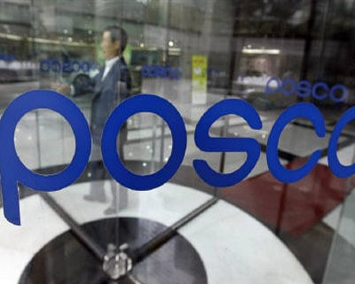 <P><b>A man goes through a revolving door at the Posco headquarters in Seoul</b>