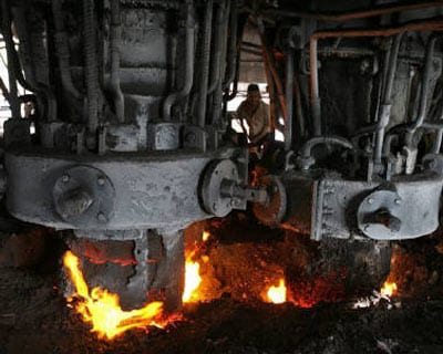 <P><B>An employee works inside a steel factory on the outskirts of Jammu.</B> </P><P> India&#39;s industrial output in January topped forecasts to grow an annual 3.7%, but high inflation is likely to make the Reserve Bank of India (RBI) lift policy